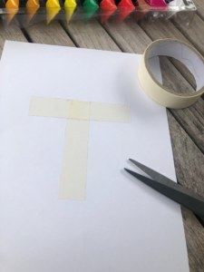 Make a T shape with tape