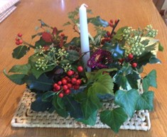 Diana's centrepiece with fresh foliage and candle